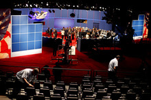 Workers sets up chairs off the set of Tuesday's presidential debate between Republican presidential candidate, former Massachusetts Gov. Mitt Romney and President Barack Obama, Monday, Oct. 15, 2012, at Hofstra University in Hempstead, N.Y. (AP Photo/David Goldman)