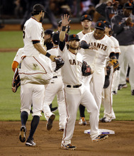 San Francisco Giants' Angel Pagan leaps in the air as he celebrates with teammates after Game 2 of baseball's National League championship series against the St. Louis Cardinals Monday, Oct. 15, 2012, in San Francisco. The Giants won 7-1 to ties the series 1-1. (AP Photo/Mark Humphrey)