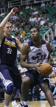 Kim Raff | The Salt Lake Tribune Derrick Favors, right, drives the basket past Brian Butch during the Jazz Scrimmage at EnergySolutions Arena in Salt Lake City on Oct. 6, 2012.