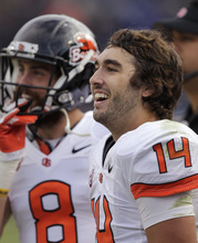 Oregon State quarterback Cody Vaz (14) smiles as he watches from the sidelines during the fourth quarter of an NCAA college football game against Brigham Young on Saturday, Oct. 13, 2012, in Provo, Utah. Oregon State defeated BYU 42-24. (AP Photo/Rick Bowmer)