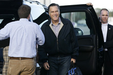 Republican presidential candidate, former Massachusetts Gov. Mitt Romney smiles as he gets out of his vehicle before he boards his campaign plane in Bedford, Mass., Tuesday, Oct. 16, 2012. (AP Photo/Charles Dharapak)