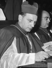 The most Rev. Alfred Bengsch, Bishop of Berlin, sits at his table in St. Peter's Basilica, during the second working session of the Roman catholic Ecumenical council, Oct. 16, 1962. (Ap Photo/Luigi Felici)