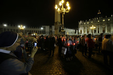 A nun takes pictures at the beginning of a candlelight procession to mark the 50th anniversary of the Second Vatican Council - the church meetings that modernized the Catholic Church but whose true results are still hotly debated - in St. Peter's square, at the Vatican, Thursday, Oct. 11, 2012. Pope Benedict XVI denounced the