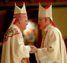 Tribune file photo Newly ordained Salt Lake Bishop George H. Niederauer, left, is greeted in January 1995 by his predecessor, Bishop William K. Weigand, who went on to serve California's Diocese of Sacramento.