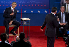 President Barack Obama sits left as Republican presidential candidate, former Massachusetts Gov. Mitt Romney, speaks during the presidential debate, Tuesday, Oct. 16, 2012, at Hofstra University in Hempstead, N.Y. (AP Photo/Carolyn Kaster)