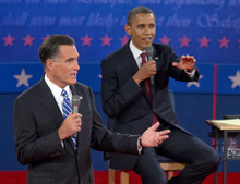 President Barack Obama, right, and Republican presidential candidate, former Massachusetts Gov. Mitt Romney, participate in the presidential debate, Tuesday, Oct. 16, 2012, at Hofstra University in Hempstead, N.Y. (AP Photo/Carolyn Kaster)