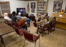 Thea Cole, third from left, comments to Ines Hellendall, second from right, as they watch the Presidential debate in the community room of their independent living apartment complex, Tuesday, Oct. 16, 2012, in Boulder City, Nev. (AP Photo/Julie Jacobson)