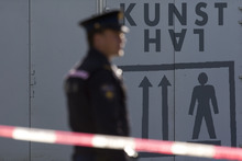 Police guard the cordoned off perimeter as three markings, left, are seen on a door after fingerprints were taken by forensic experts at Kunsthal museum in Rotterdam, Tuesday Oct. 16, 2012.  Several paintings have been stolen from a museum in the Dutch city of Rotterdam that was exhibiting works by Pablo Picasso, Henri Matisse and Vincent van Gogh.  At least several paintings were stolen early Tuesday morning from the Kunsthal museum , but their names have not yet been released. They are believed to include at least one by Henri Matisse, the 1919