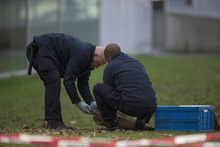 Forensic experts take samples of imprints at Kunsthal museum in Rotterdam, Netherlands, Tuesday Oct. 16, 2012.  Several paintings have been stolen from a museum in the Dutch city of Rotterdam that was exhibiting works by Pablo Picasso, Henri Matisse and Vincent van Gogh.  At least several paintings were stolen early Tuesday morning from the Kunsthal museum , but their names have not yet been released. They are believed to include at least one by Henri Matisse, the 1919