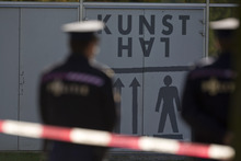 Police guards the cordoned off perimeter as three markings, left, are seen on a door after fingerprints were taken by forensic experts at Kunsthal museum in Rotterdam, Tuesday Oct. 16, 2012.  Several paintings have been stolen from a museum in the Dutch city of Rotterdam that was exhibiting works by Pablo Picasso, Henri Matisse and Vincent van Gogh.  At least several paintings were stolen early Tuesday morning from the Kunsthal museum , but their names have not yet been released. They are believed to include at least one by Henri Matisse, the 1919