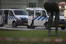 A forensic expert talks on his mobile phone as police vehicles are parked near a statue at the back entrance of Kunsthal museum in Rotterdam, Tuesday Oct. 16, 2012.  Several paintings have been stolen from a museum in the Dutch city of Rotterdam that was exhibiting works by Pablo Picasso, Henri Matisse and Vincent van Gogh.  At least several paintings were stolen early Tuesday morning from the Kunsthal museum , but their names have not yet been released. They are believed to include at least one by Henri Matisse, the 1919