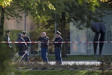 Police officers guard a cordoned off area at the rear side of the Kunsthal museum in Rotterdam, Tuesday Oct. 16, 2012.  Several paintings have been stolen from a museum in the Dutch city of Rotterdam that was exhibiting works by Pablo Picasso, Henri Matisse and Vincent van Gogh.  At least several paintings were stolen early Tuesday morning from the Kunsthal museum , but their names have not yet been released. They are believed to include at least one by Henri Matisse, the 1919