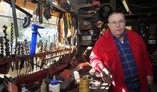 Retired sheriff's deputy Paul Main poses in his shop at his home Tuesday, Oct. 16, 2012 in Alfred, Maine. Main's phone has been ringing off the hook since a person with his same name, accused of visiting a prostitute in Kennebunk, was released on Monday. (AP Photo/Jim Cole)