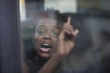 A young suspected crack user reacts as she sits inside a van waiting to be taken to a shelter after being removed from the streets near the Parque Uniao slum in Rio de Janeiro, Brazil, Wednesday, Oct. 17, 2012. A crew of social workers, psychologists and police rounded up drug users found in the streets Wednesday, and took them to shelters. The adults don't have to stay, and the majority leave as soon as they've had a meal and a shower. (AP Photo/Felipe Dana)