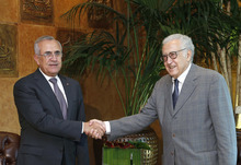 In this photo released by Lebanon's official government photographer Dalati Nohra, Lebanese President Michel Suleiman, left, shakes hands with U.N.-Arab League envoy for Syria, Lakhdar Brahimi, at the Lebanese presidential palace, in Baabda east of Beirut, Lebanon, Wednesday, Oct. 17, 2012. Brahimi is in Beirut to meet with Lebanese officials. (AP Photo/Dalati Nohra, HO) EDITORIAL USE ONLY, NO SALES