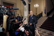 French foreign minister Laurent Fabius, right, addresses reporters at the start of a conference of representatives of Syrian rebels, at the Quai d'Orsay in Paris, Wednesday, Oct. 17, 2012. Delegates of Syrian revolutionary councils are meeting in Paris Wednesday with officials from some 20 countries to plan an expansion of a French initiative of direct aid to beleaguered rebel-held towns in Syria. (AP Photo/Remy de la Mauviniere)