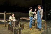 Joe Tapper (left) plays George with Patrick Halley as Curley, Bill Cwikowski as Candy and Mark David Watson as Lennie in Pioneer Theatre Company's production of John Steinbeck's