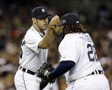 Detroit Tigers' Justin Verlander congratulates first baseman Prince Fielder after New York Yankees' Raul Ibanez grounded out to Fielder in the seventh inning during Game 3 of the American League championship series Tuesday, Oct. 16, 2012, in Detroit. (AP Photo/Paul Sancya )