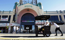 FILE - In this Monday, Sept. 20, 2010 file photo, people take a ride in a pushcart along the Boardwalk in front of Schiff's Central Pier in Atlantic City, N.J. Atlantic City is spending $20 million this year on a