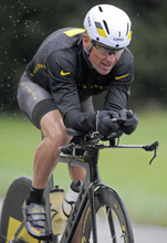 FILE - In this Oct. 7, 2012, file photo, Lance Armstrong competes wearing Nike gear in the Rev3 Half Full triathalon in Ellicott City, Md. Nike said Wednesday, Oct. 17, 2012 that it is severing ties with Armstrong, citing insurmountable evidence that the cyclist participated in doping and misled the company for more than a decade.  (AP Photo/Steve Ruark, File)