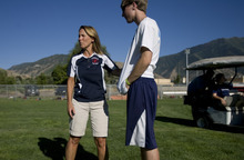 Kim Raff | The Salt Lake Tribune Lisa Walker, the Springville High School athletic trainer, talks with Kevin Payne during Springville High School football practice in Springville in August.  Payne had recently sustained a non-football related concussion and Walker was talking to him about his sensitivity to light due to the concussion.