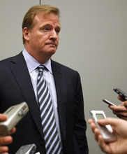 FILE - This Oct. 3, 2011 file photo shows NFL football Commissioner Roger Goodell speaking to reporters after speaking about concussions at the Congress of Neurological Surgeons, in Washington. A concussion-related lawsuit bringing together scores of cases has been filed in federal court, accusing the NFL of hiding information that linked football-related head trauma to permanent brain injuries.  (AP Photo/Jacquelyn Martin, File)