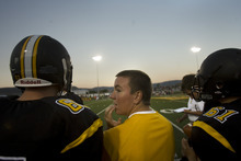 Kim Raff | The Salt Lake Tribune Koen Hyde sustained a severe concussion during wrestling season last spring that has kept him on the sidelines this football season. Hyde stands on the sidelines and watches the Wasatch High School varsity football team play a home game against Juab in Heber on Sept. 7, 2012.