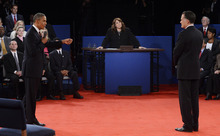 Moderator Candy Crowley, center, listens to President Barack Obama, left, and Republican presidential nominee Mitt Romney during the second presidential debate at Hofstra University, Tuesday, Oct. 16, 2012, in Hempstead, N.Y. (AP Photo/Pool-Michael Reynolds)