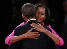 President Barack Obama is hugged by his wife Michelle following the second presidential debate with Republican presidential nominee Mitt Romney at Hofstra University, Tuesday, Oct. 16, 2012, in Hempstead, N.Y. (AP Photo/Pool-Shannon Stapleton)