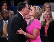Republican presidential nominee Mitt Romney kisses his wife Ann following the second presidential debate with President Barack Obama at Hofstra University, Tuesday, Oct. 16, 2012, in Hempstead, N.Y. (AP Photo/Pool-Win McNamee)