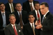 Audience members listen as Republican presidential nominee Mitt Romney speaks during the second presidential debate at Hofstra University, Tuesday, Oct. 16, 2012, in Hempstead, N.Y. (AP Photo/Eric Gay)