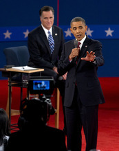 President Barack Obama speaks as Republican presidential candidate, former Massachusetts Gov. Mitt Romney, listens during the second presidential debate Tuesday, Oct. 16, 2012, at Hofstra University in Hempstead, N.Y. (AP Photo/Carolyn Kaster)