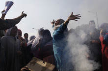 Kashmiri Muslim women shout anti-government slogans after they burn an effigy of Jammu and Kashmir state Chief Minister Omar Abdullah during a protest in  Srinagar, India, Wednesday, Oct. 17, 2012. Dozens of residents  blocked traffic and protested against the government decision to hike electricity bills and for capping the number of subsidized cooking gas cylinders at six a year. (AP Photo/ Dar Yasin)