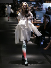 A model displays a creation by Olga during the 2013 spring/summer collection at Tokyo Fashion Week in Tokyo Wednesday, Oct. 17, 2012. (AP Photo/Itsuo Inouye)