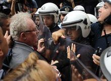 Lawyers and doctors scuffle with riot police during an anti-austerity protest outside the Finance Ministry in Athens, Wednesday, Oct. 17, 2012. Civil servants and private sector workers stage a nationwide general strike on Thursday to protest new austerity measures the government is still negotiating with the debt-ridden country's international creditors. (AP Photo/Thanassis Stavrakis)