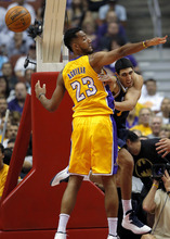 Utah Jazz's Enes Kanter, right, passes the ball as he is defended by Los Angeles Lakers' Ronnie Aguilar during the first half of an NBA preseason basketball game in Anaheim, Calif., Tuesday, Oct. 16, 2012. (AP Photo/Jae Hong)