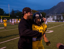 Trent Nelson  |  The Salt Lake Tribune Cottonwood's Inoke Lotuleilei celebrates a touchdown with assistant coach Tony Trujillo as Cottonwood hosts Jordan High School football at Rice-Eccles Stadium in Salt Lake City.
