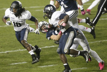 Chris Detrick  |  The Salt Lake Tribune Utah State Aggies running back Kerwynn Williams (25) runs past Brigham Young Cougars defensive back Daniel Sorensen (9) during the first half of the game at LaVell Edwards Stadium Friday October 5, 2012. BYU is winning the game 6-3.