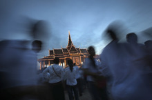 People gather at the Royal Palace to mourn their former King Norodom Sihanouk in Phnom Penh, Cambodia, Wednesday Oct. 17, 2012. The body of Sihanouk returned to his homeland on a plane from China on Wednesday, welcomed by tens of thousands of mourners who packed tree-lined roads in the Southeast Asian nation's capital ahead of the royal funeral. (AP Photo/Wong Maye-E)