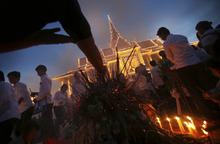 Mourners burn incense and offer prayers at the Royal Palace displaying a portrait of their former King Norodom Sihanouk in Phnom Penh, Cambodia, Wednesday Oct. 17, 2012. The body of Sihanouk returned to his homeland on a plane from China on Wednesday, welcomed by tens of thousands of mourners who packed tree-lined roads in the Southeast Asian nation's capital ahead of the royal funeral. (AP Photo/Wong Maye-E)