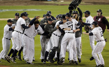 The Detroit Tigers celebrate after winning Game 4 of the American League championship series 8-1, against the New York Yankees, Thursday, Oct. 18, 2012, in Detroit. The Tigers move on to the World Series. (AP Photo/Charlie Riedel)