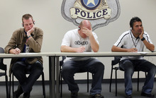 Al Hartmann  |  The Salt Lake Tribune Law enforcement officers listen to simulated sounds (voices) of what mentally ill people might hear in everyday life and try to recall and write down details in a memorization exercise. The training on Thursday was part of a weeklong Crisis Intervention Team (CIT) education program designed to help officers gain an understanding and empathy when they deal with the mentally ill in the course of their jobs.