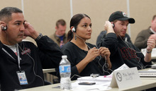 Al Hartmann  |  The Salt Lake Tribune Members of law enforcement put on headphones in a Crisis Intervention Team class Thursday. Officers listened to voices that simulated the kind of auditory hallucinations some mentally ill people might hear in everyday life while they tried to perform other training excercises. The purpose was to gain an understanding and empathy for dealing with the mentally ill in the course of their jobs.