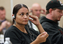 Al Hartmann  |  The Salt Lake Tribune Margarita Killpack with Adult Pobation puts on headphones with other members of crisis intervention team law enforcement class.  The police listened to simulated sounds (voices) of what mentally ill people might hear in everyday life while performing other training excercises.    The purpose was to gain an understanding and empathy for dealing with the mentally ill in the course of their jobs.
