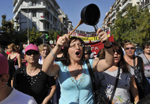 Protesters shout slogans during a 24-hour nationwide general strike in the northern Greek port city of Thessaloniki on Thursday, Oct. 18, 2012. About 17,000 people rallied peacefully during the country's second general strike in a month as workers across the country walked off the job to protest new austerity measures the government is negotiating with Greece's international creditors. (AP Photo/Giorgos Nissiotis)