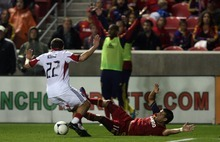 Kim Raff | The Salt Lake Tribune (right) Real Salt Lake player Javier Morales #11 is fouled by D.C. United player Chris Korb during a game at Rio Tinto Stadium in Sandy, Utah on September 1, 2012.  Real Salt Lake went on to win the game 1-0.