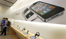 Tony Avelar/Bloomberg Apple's products may seem bigger than life to some fans, but truth is they also contain flaws that are worthy of comment.