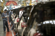 (AP Photo/Eugene Hoshiko) Industrial output from such sectors as automobile manufacturing grew 9.2 percent in China, compared with a year earlier, and retail sales expanded 14.2 percent. Both figures beat expectations and improved on the expansions in August.