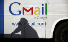 FILE - In this Monday, Sept 17, 2012, file photo an unidentified man's shadow reflects on a commercial bus with an advertisement for Google Mail, in Lagos, Nigeria. Google Inc.'s stock plunged suddenly on Thursday Oct. 18, 2012, after a contractor prematurely released the search company's third-quarter earnings report. (AP Photo/Sunday Alamba)