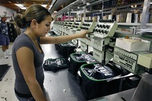 Scott Sommerdorf  |  The Salt Lake Tribune SanSegal, which generated most of its revenue printing, silk screening and decorating T-shirts and other apparel, was hard hit by the Great Recession.